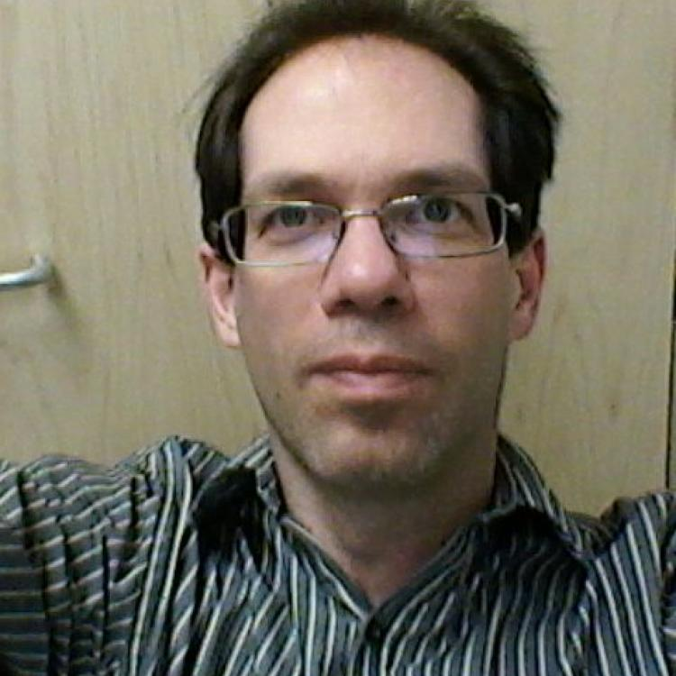 Dr.  Greg Salomons